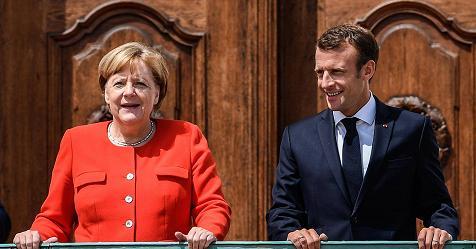 """Migranti, Macron e Merkel d'accordo sui respingimenti. Sì all'Italia: """"Serve una risposta europea"""" – Rai News"""